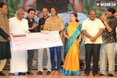 Dev Gouda Presents Rs.10 Lakhs to PV Sindhu at 'Jaguar' Audio Launch