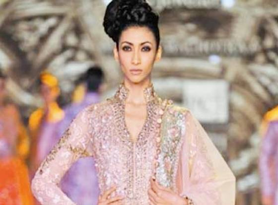 Models wear lehengas as heavy as 35kg
