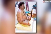 A professor performs nude Puja