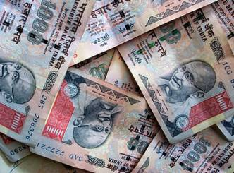 Rupee falls 21 paise against USD